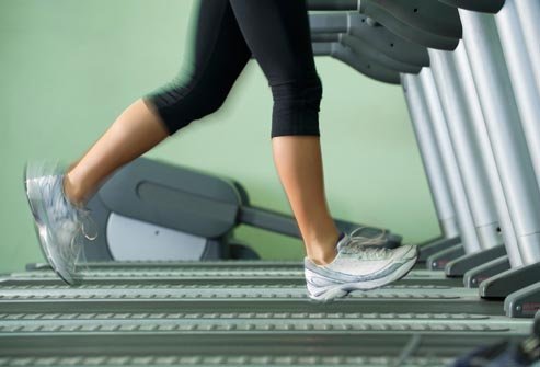 getty_rf_photo_of_woman_on_treadmill