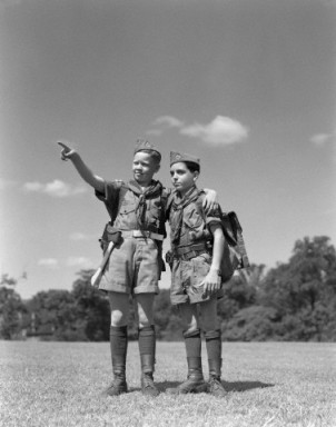 1950s two boy scouts one pointing wearing hiking gear uniforms