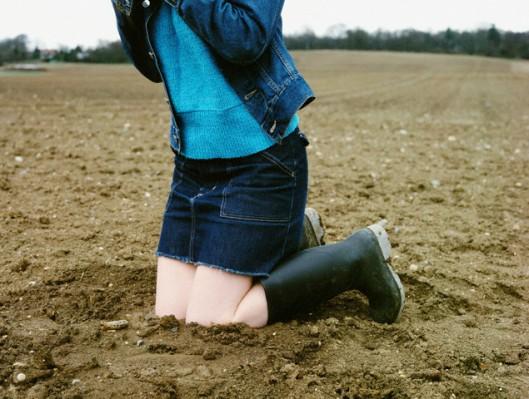 Woman Kneeling Down in the Mud